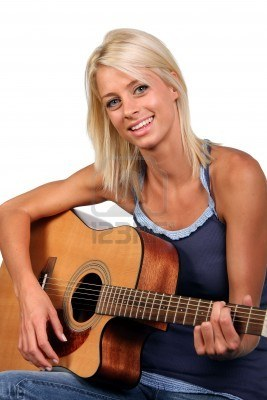 4321450-beautiful-blonde-girl-with-happy-smile-playing-an-accoustic-guitar