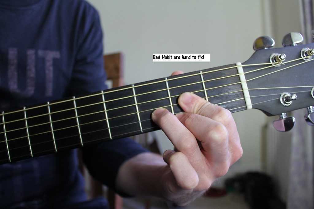 Bed Position on guitar, bad posture on guitar. Bed habit on guitar are difficutl to fix! You need a guitar teacher.